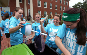 Senior Paige Gaddy (second from right) helps move a new student's belongings into Randolph Hall.