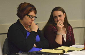 Ghislaine Storr Burks, left, and Anna Lindemann deliberate during a mock trial rehearsal.