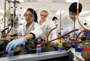 Kelli Slunt keeps a close eye on two up-and-coming chemists inside a state-of-the-art Jepson Science Center lab. om across the country competed to represent the U.S. in July's 48th International Chemistry Olympiad. (Photo by Norm Shafer).