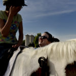 UMW students participate in the therapeutic horseback riding program at Hazelwild Farm. Photo by Reza A. Marvashti.