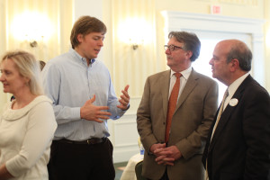 President of the Learning By Giving Foundation Alex Buffett Rozek (left) talks with President Richard V. Hurley (center) and Torre Meringolo