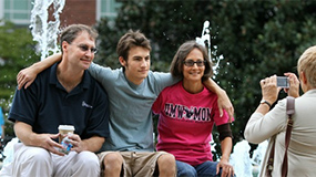 Family being photographed at Family Weekend