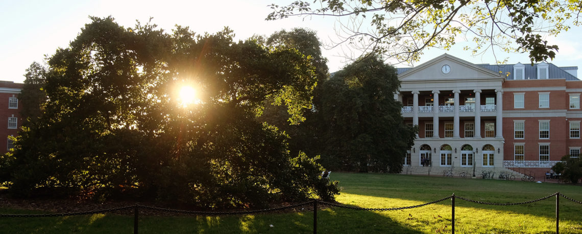 Sun shining through trees in front of the University Center