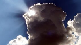 rays of light peeking out from behind a cloud.