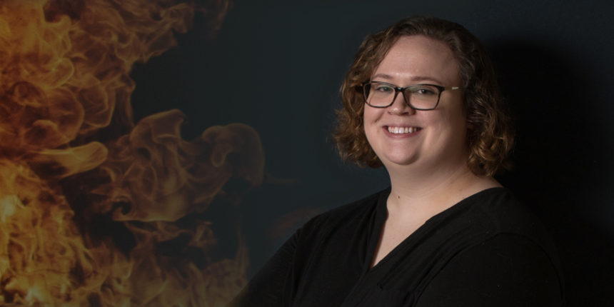 Kelsey Keplinger, who recently defended her capstone project for UMW's master's in geospatial analysis degree, uses satellite pixels to match fires with terrorist events. Photo by Clement Britt.