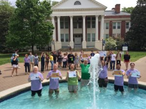 "Department of Geography professors went ""all in"" into the Palmieri Fountain in front of Monroe Hall on April 24 to thank their Giving Day donors."