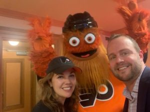 Mike Shane and wife Sarah at the Wells Fargo Center with the Philadelphia Flyers' Gritty, who in just a few years has become one of sports' most recognizable mascots.